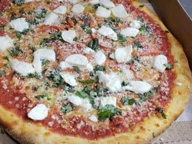 Deliworks Pizzeria margarita pizza